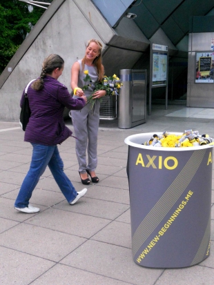 Promo girls giving out roses and smiles for Axio